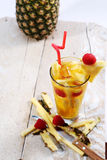 Fresh juice with pineapple slice Stock Photo