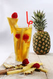 Fresh juice with pineapple slice Royalty Free Stock Image