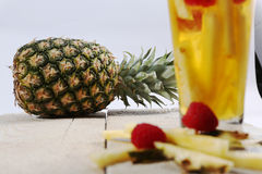 Fresh juice with pineapple slice Stock Image