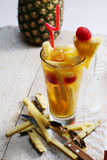 Fresh juice with pineapple slice Stock Photos