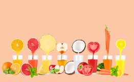 Juice flowing from fruits into the glass on pastel background stock photos