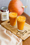 Fresh juice. Pumpkin smoothie in the glass Stock Photo