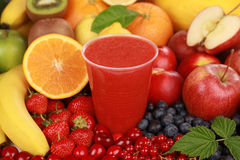 Fresh juice from red fruits. Freshly squeezed juice from red fruits in a cup stock photo