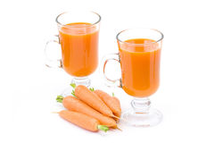 Fresh juice and some fresh carrots Royalty Free Stock Photo