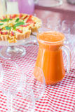 Fresh juice on a table in a restaurant. Healthy drinks. carrot fresh in a jar Royalty Free Stock Photos