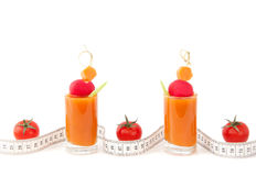 Fresh juice and tape measure background Stock Image
