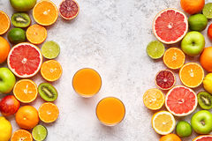 Fresh juice vitamin c drink in citrus fruits background flat lay, helthy vegetarian organic antioxidant detox stock photos