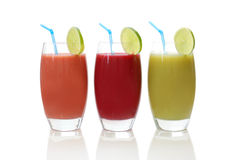 Fresh juices. Freshly made fruit juices isolated on white stock images
