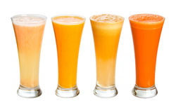 Fresh juices. Four glasses of fresh juices. Grapefruit, orange, apple, carrot Stock Image