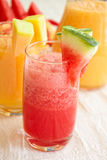 Fresh juices. Watermelon and melon juices in glasses for a nice weekend Stock Image