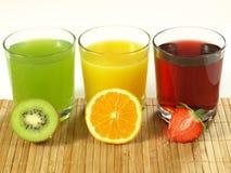 Fresh juices. Kiwi, orange and strawberry fruit with fresh juices royalty free stock photography