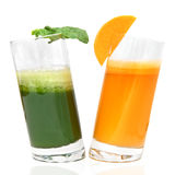 Fresh juices from carrot and parsley in glasses Royalty Free Stock Photo