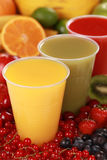 Fresh juices in drinking cups Stock Images