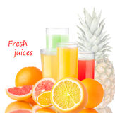Fresh juices with fruits. Fresh juices from grapefruit,orange and pineapple in highball glasses near the fruits Stock Photo