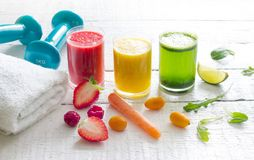 Fresh juices and gym equipment sport fitness healthy diet lifestyle concept. Closeup royalty free stock image