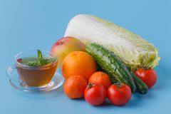 Fresh juices measuring tape fruits and vegetables lose weight diet concept stock photos