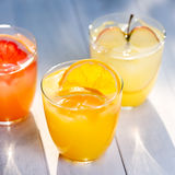 Fresh juices of  oranges, apples and grapefruits Royalty Free Stock Photos