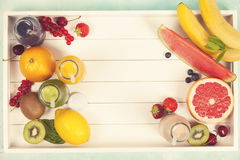 Fresh juices or smoothies with fruits and vegetables in wooden t stock photos