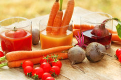 Fresh juices of vegetables Royalty Free Stock Photo