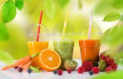 Fresh juices on white table. Healthy drinks stock photos