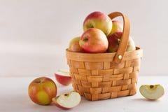 Fresh juicy apples in basket Stock Photos