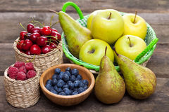 Fresh juicy apples, pears and berries Royalty Free Stock Photos