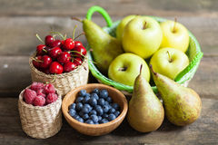 Fresh juicy apples, pears and berries Royalty Free Stock Image