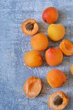 Fresh, juicy apricots on a concrete gray background. Bio food Royalty Free Stock Photos