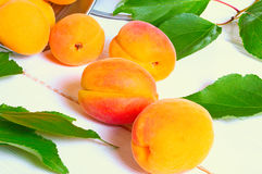 Fresh juicy apricots. In the leaves on the wooden background Royalty Free Stock Photo