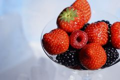 Fresh juicy berries, strawberries, raspberries, blackberries in a glass cocktail glass. Fresh juicy berries, strawberries, raspberries, blackberries in a glass Royalty Free Stock Photos