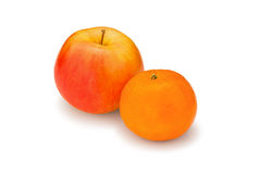 Fresh, juicy, bright apple and mandarin on a white background Royalty Free Stock Images