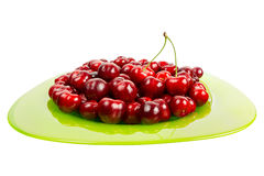 Fresh juicy Cherries fruits in a green glass bowl isolated on white background Royalty Free Stock Photos