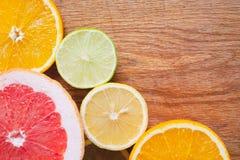 Fresh juicy citrus fruit in wood background.