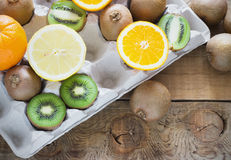 Fresh juicy citrus fruits in a box tray on  wooden background Royalty Free Stock Photography
