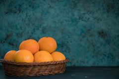 Fresh juicy clementines tangerines in a basket, fruit in winter. horizontal view of mandarin. copy space royalty free stock images
