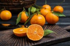Fresh juicy cut tangerine. On wooden board royalty free stock image
