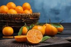 Fresh juicy cut tangerine. On wooden board royalty free stock photo