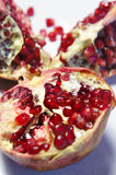 Fresh juicy cuted pomegranate Royalty Free Stock Image