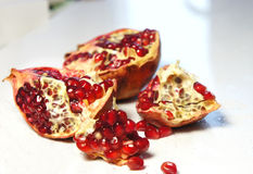Fresh juicy cuted pomegranate Royalty Free Stock Photography