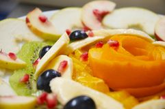Fresh juicy fruit salad on a plate. Stock Photo