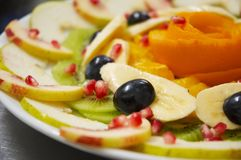 Fresh juicy fruit salad on a plate. Stock Photos