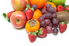 Fresh juicy fruits and berries close-up on a white background Royalty Free Stock Photography