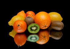 Fresh juicy fruits on a black background Royalty Free Stock Image