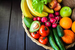 Fresh juicy  fruits and vagetable in a basket Stock Photo