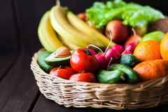 Fresh juicy  fruits and vagetable in a basket Stock Images