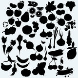Fresh, juicy fruits and vegetables, set of harvest. On blue background. Vector silhouettes Royalty Free Stock Image