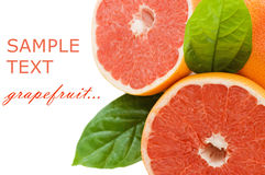 Fresh juicy grapefruits with green leafs. Isolated on white background Stock Photos