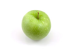 Fresh juicy green apple with water drops Stock Photos