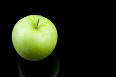 Fresh juicy green apple with waterdrops Stock Photo