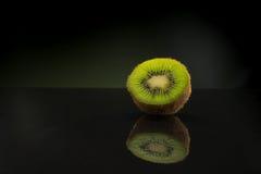 fresh and juicy green kiwi on black background, healthy Stock Image